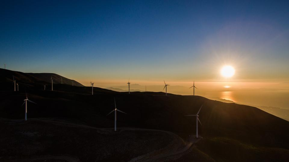 dark sunset windmill solar energy highland mountain landscape blue sky sunlight sunshine