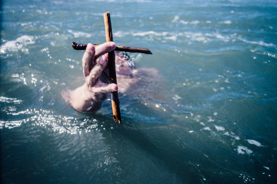 guy man male people hands fingers hold wood wooden cross nature water ocean sea bubbles underwater submerged blue