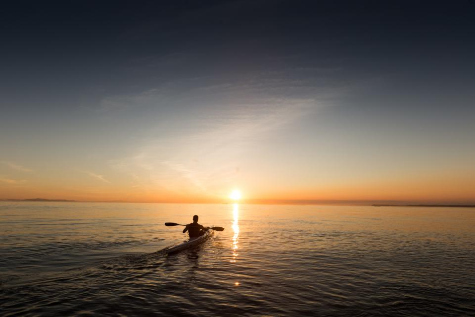 kayak lake water sunset horizon dusk sky landscape nature outdoors people