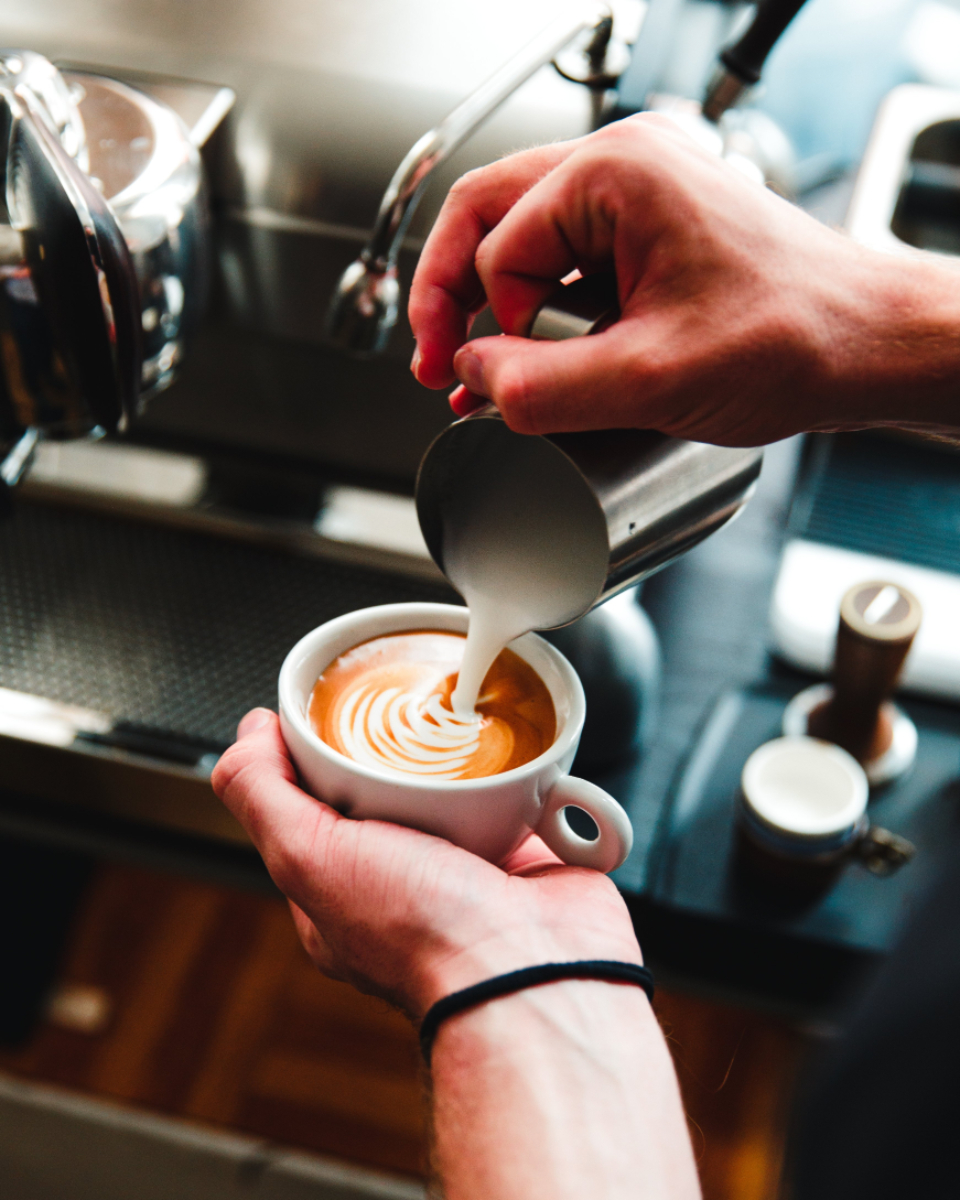 barista latte art pouring coffee hot coffee fresh coffee espresso cafe restaurant hands milk beverage drink cappuccino coffee culture breakfast drink moccha