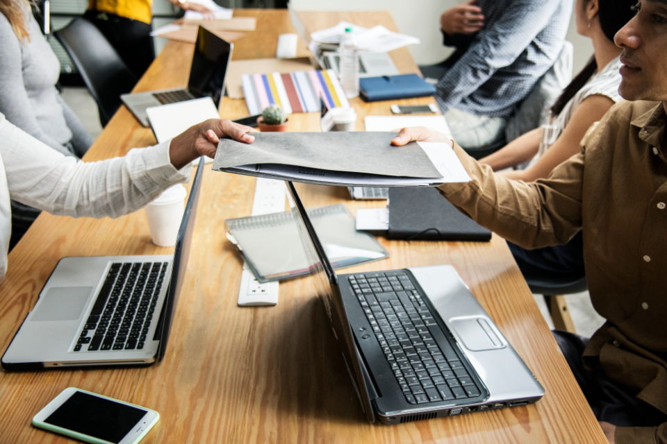 brainstorming business communication computer connection digital device discussion diverse entrepreneur expression folder friends giving group handing hands information laptop man meeting mobile phone network not