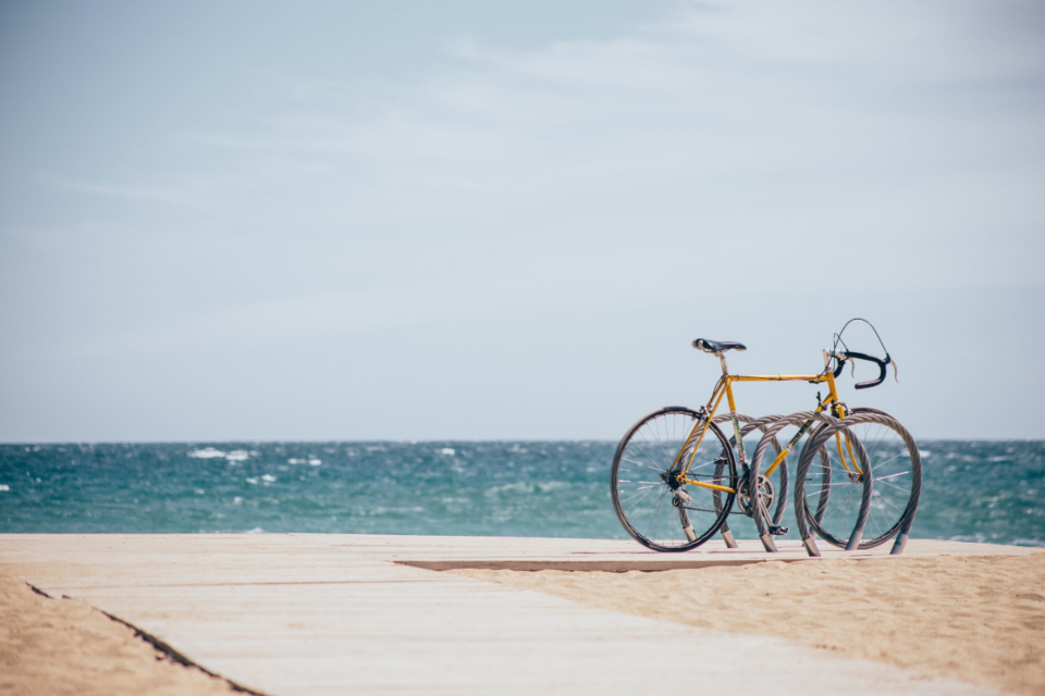 beach boardwalk bike summer ocean water sky cycling sand coastal nature outdoors pathway shore vacation bicycle travel