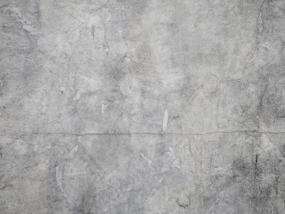 gray wall cracks cement scratches