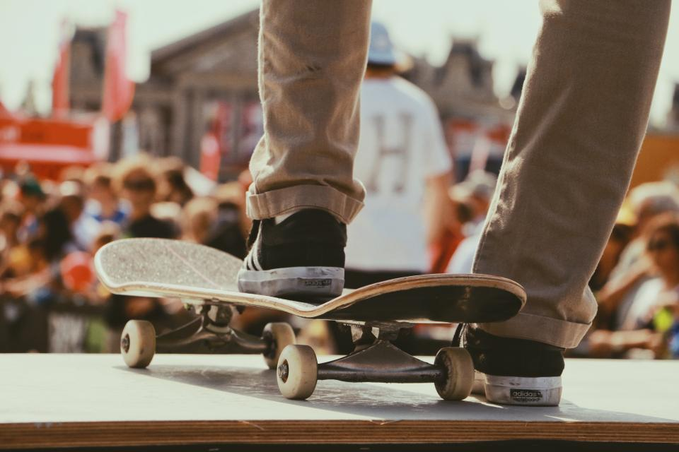 skateboard games sports people crowd men stage legs shoes footwear