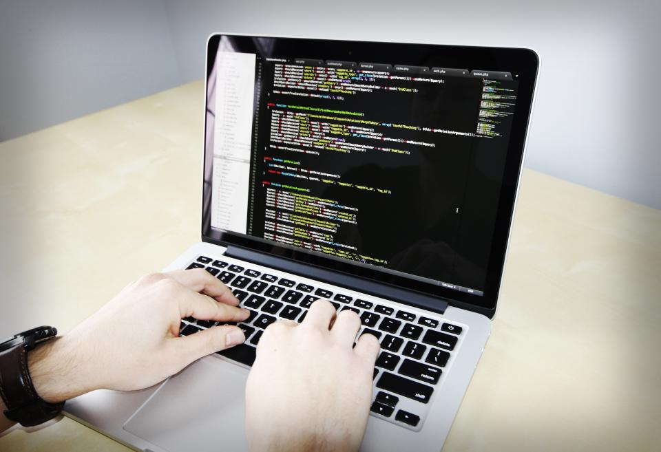 coding business working macbook laptop computer technology programming sublime text software PHP laravel code