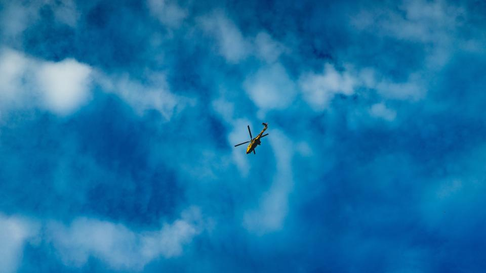 helicopter aircraft flight travel trip clouds blue sky