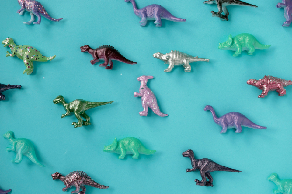 ancient animals assorted assortment background blue background childhood closeup collection colorful dinosaur diverse elephant extinct figure figurine happy hippo hippopotamus horse isolated jungle jurassic lion mammals mixed