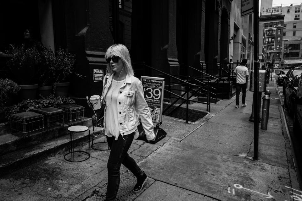 urban city street walking people lady girl shades woman black and white grayscale