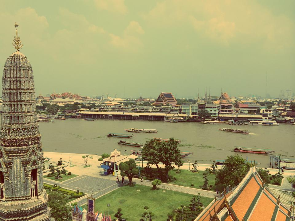 bangkok thailand river water boats ships Asia architecture buildings city