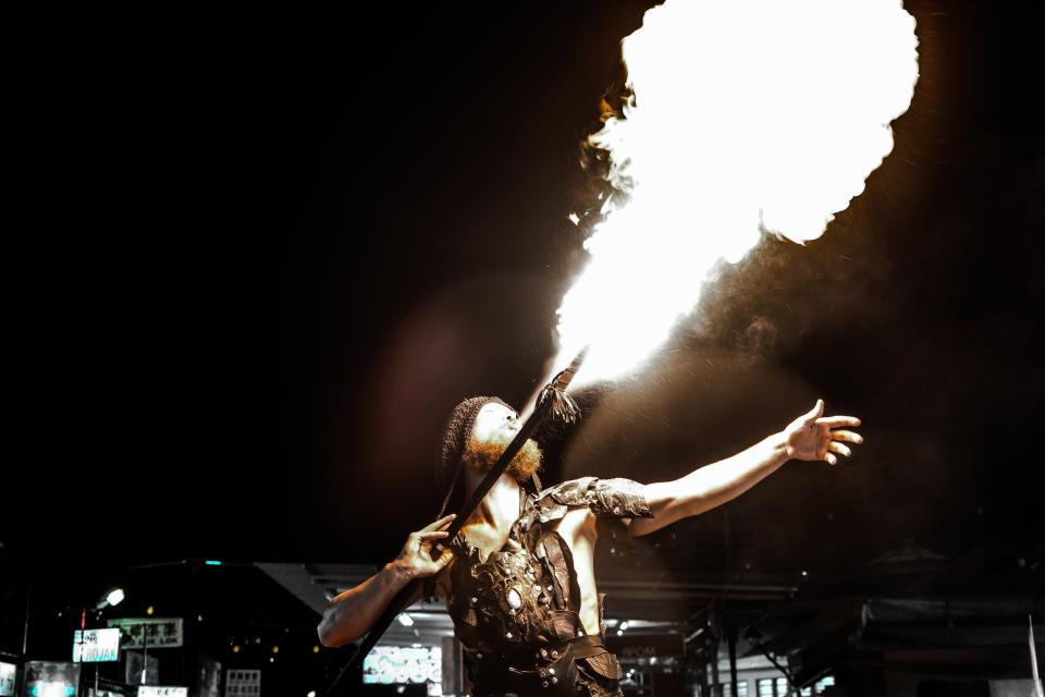 crafts hobby fire breathing show display business performance job guy man male people night fire flames light