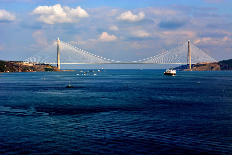 sea ocean water blue sky cloud nature bridge structure ship transportation horizon mountain landscape