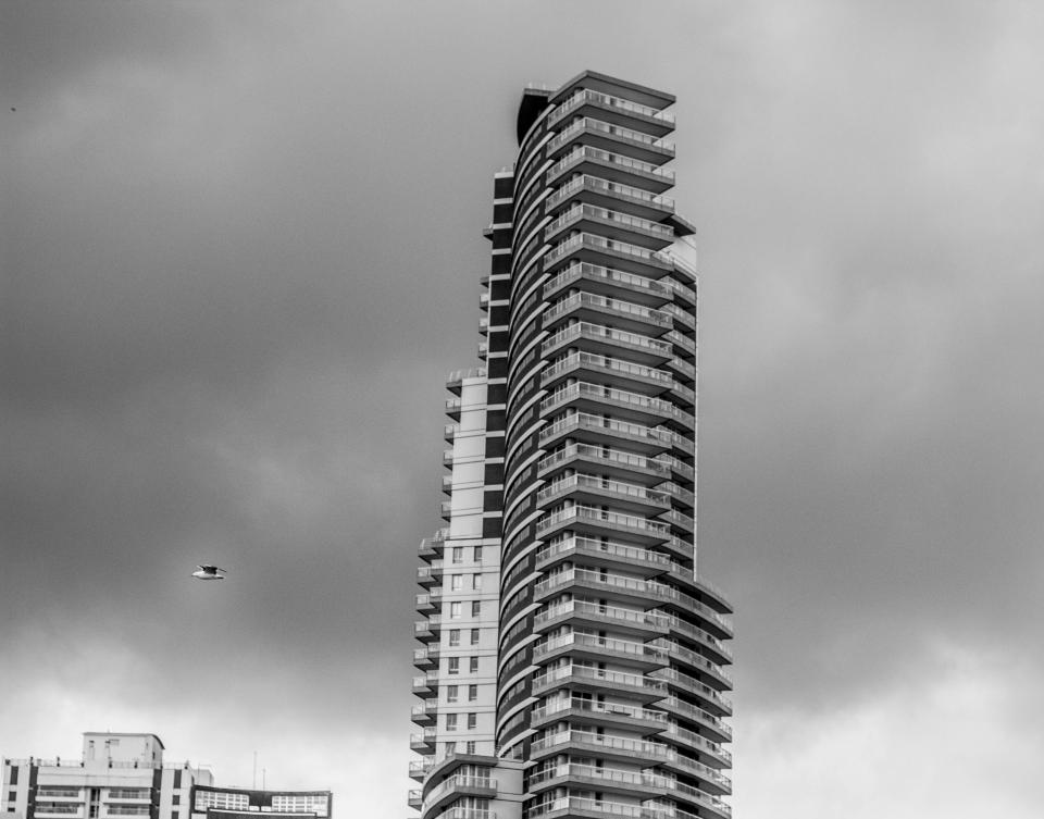 building city urban sky clouds black and white grayscale skyscraper
