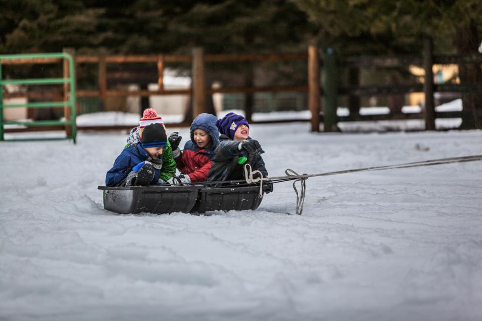 people kids children boys playing snow winter cold outdoor adventure