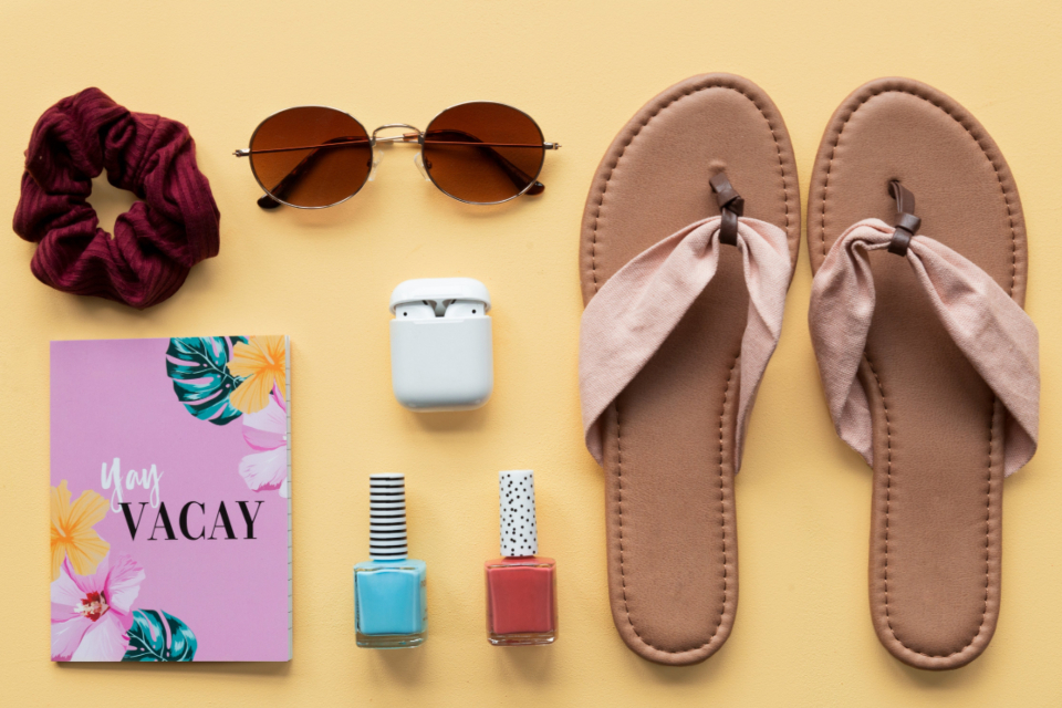 travel kit vacation sunglasses sandals cosmetics airpods baggage packing top relax leisure flat lay pastel feminine fashion