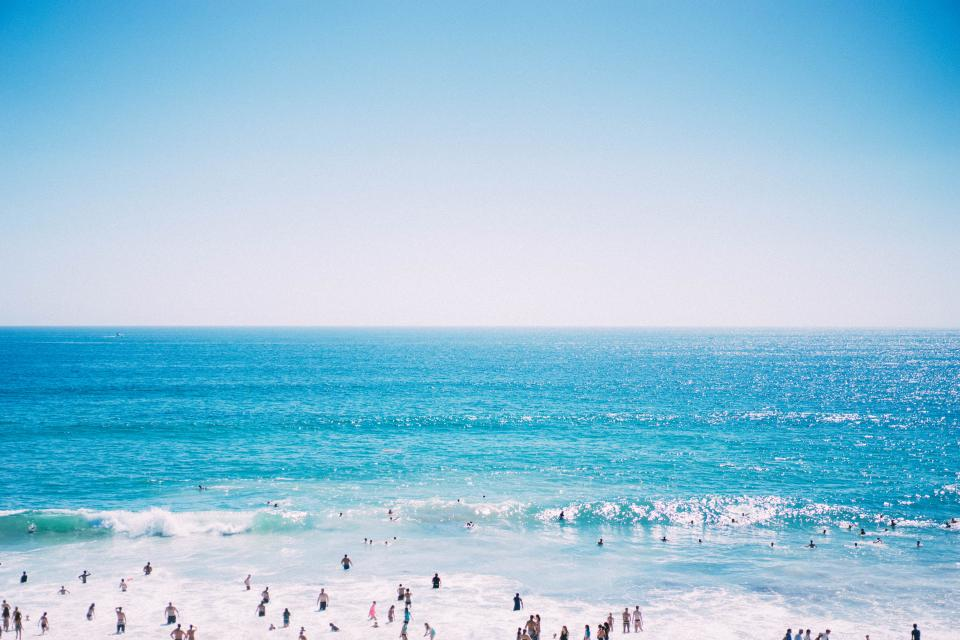 sea ocean blue water waves horizon sky cloud people swimming summer beach outdoor nature