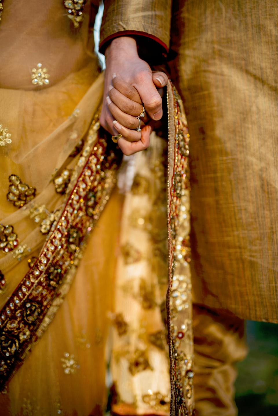 gold marriage wedding people man woman holding hands