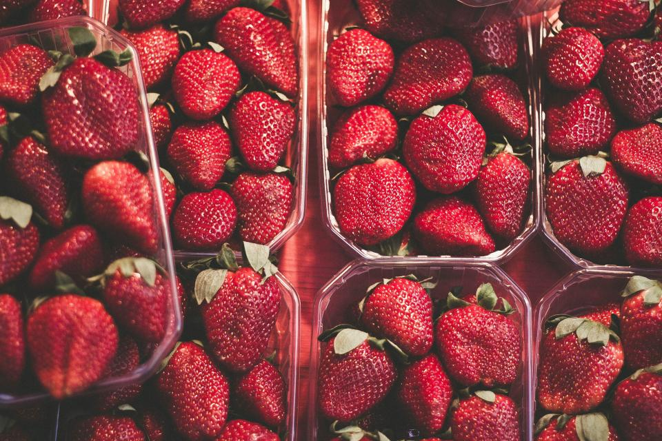 food fruits strawberries containers stack pile red