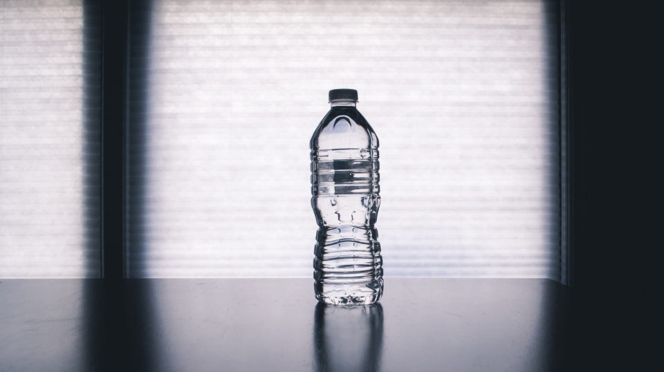 water bottle table object windows sunlight liquid drink beverage thirst isolated plastic