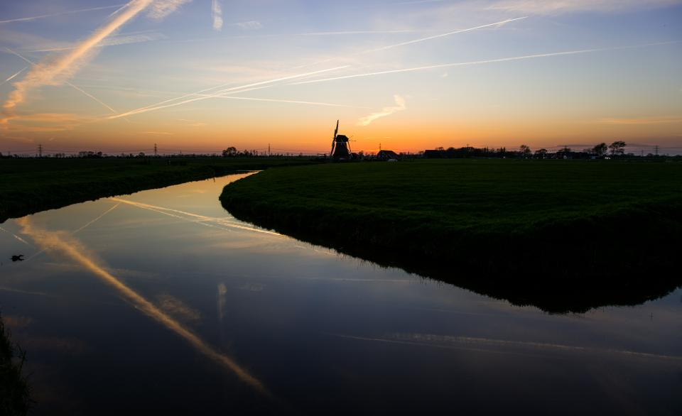sunset dusk dark sky windmill lanscape water grass river