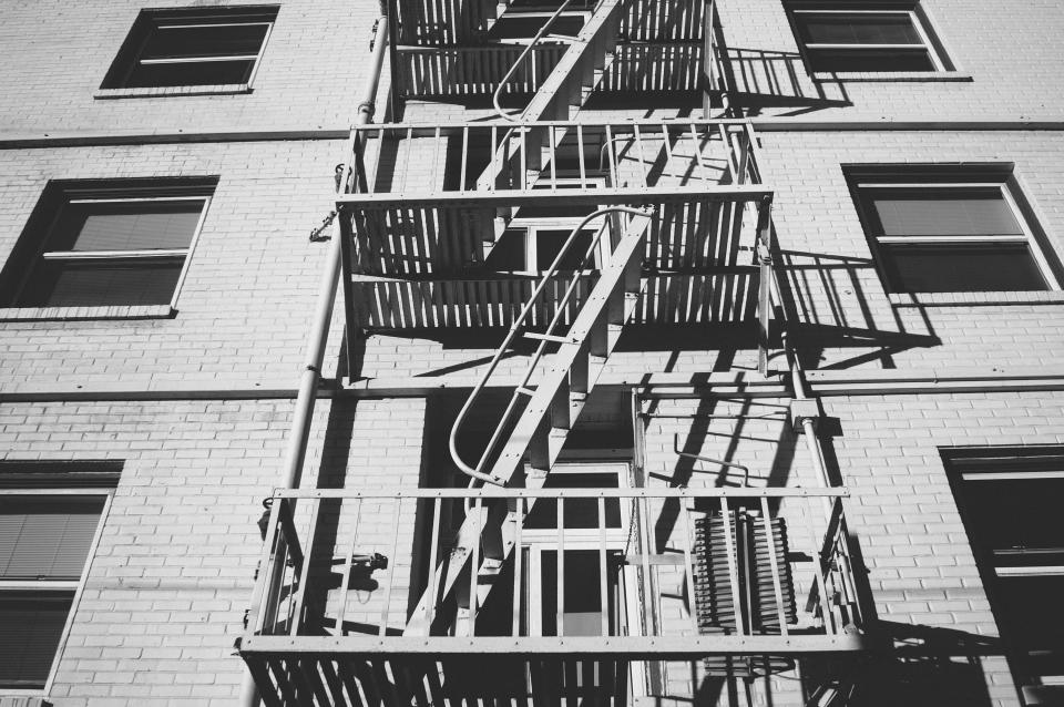 fire escape emergency stairs apartment building bricks windows steps