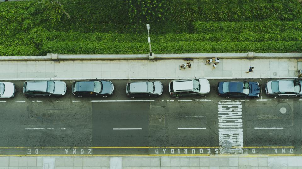 road lane car vehicle traffic green grass plant aerial view