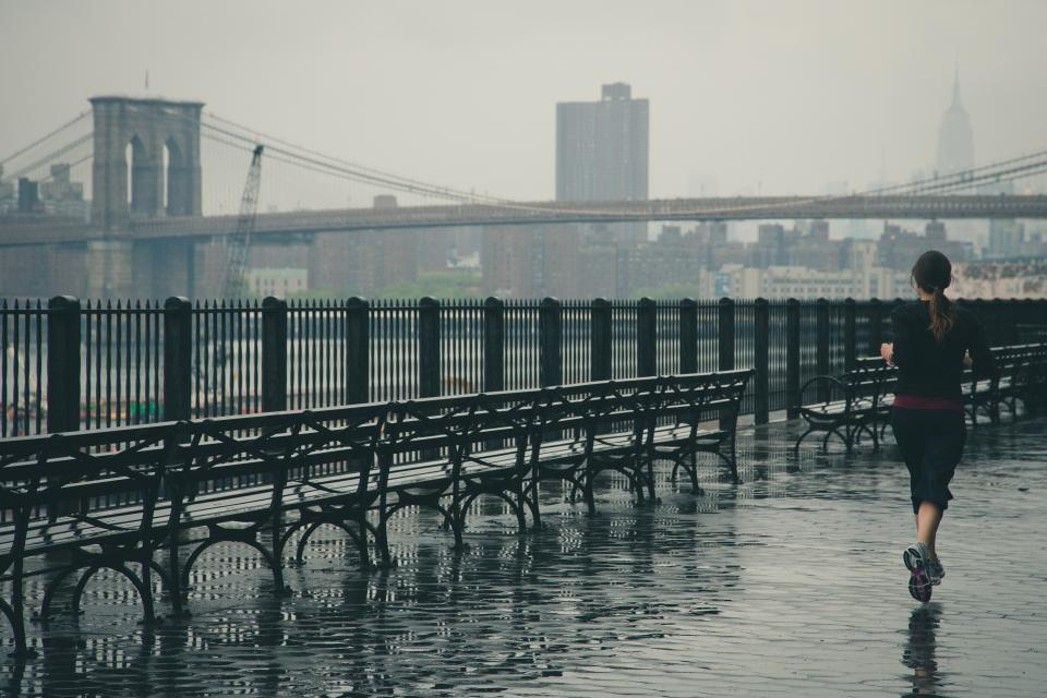 girl woman runner running fitness sports active fit bridge architecture rain raining wet benches railings city jogging
