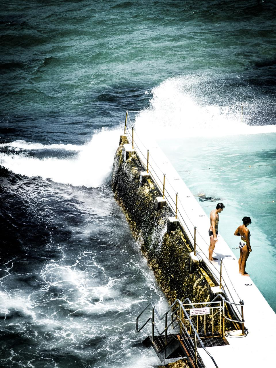 sea ocean water pool fence people couple man woman swimming