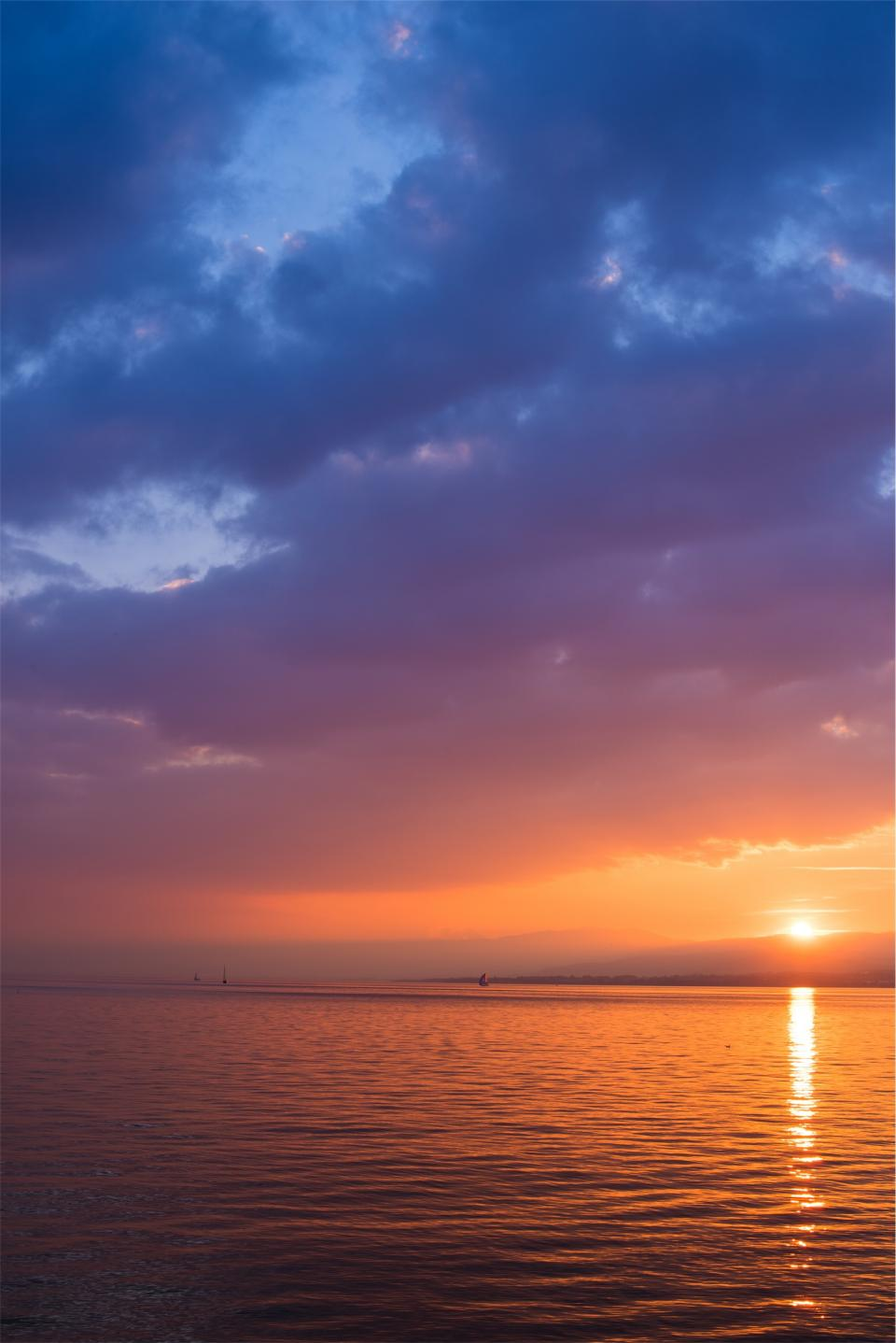 sunset dusk sky clouds purple ocean sea water