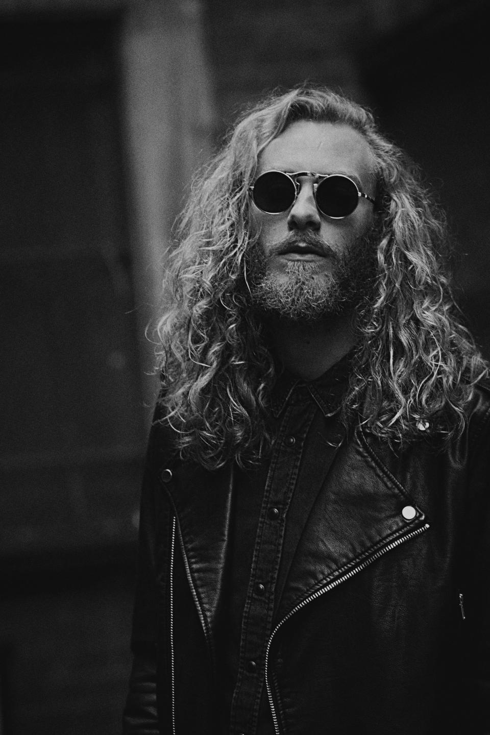 people man guy black leather jacket rock curly hair beard sunglasses black and white