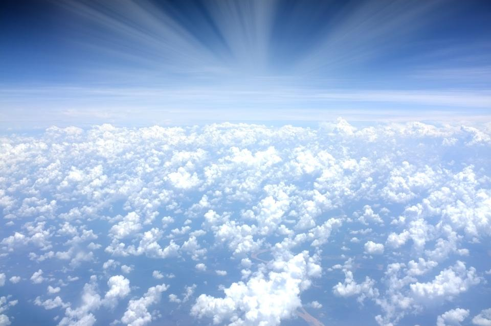 above the clouds sky blue aerial view