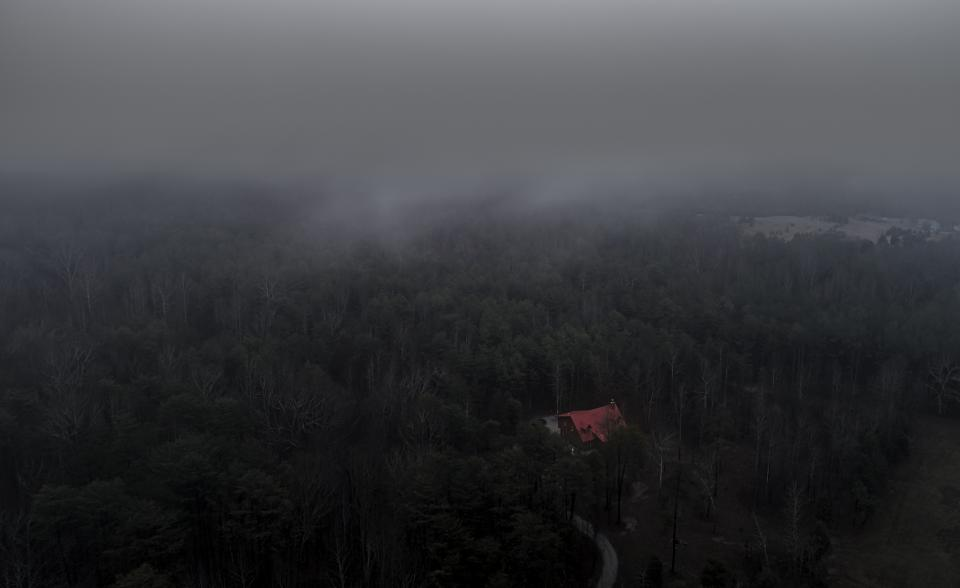 aerial fog forest woods dark house home building cabin