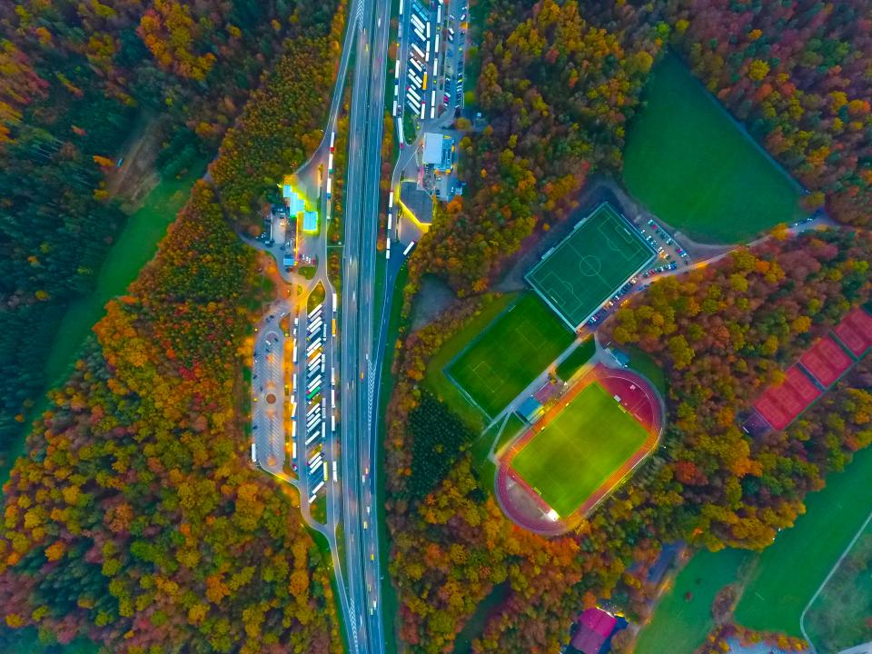 aerial view autumn fall trees plant nature green field landscape sport venue court building road light