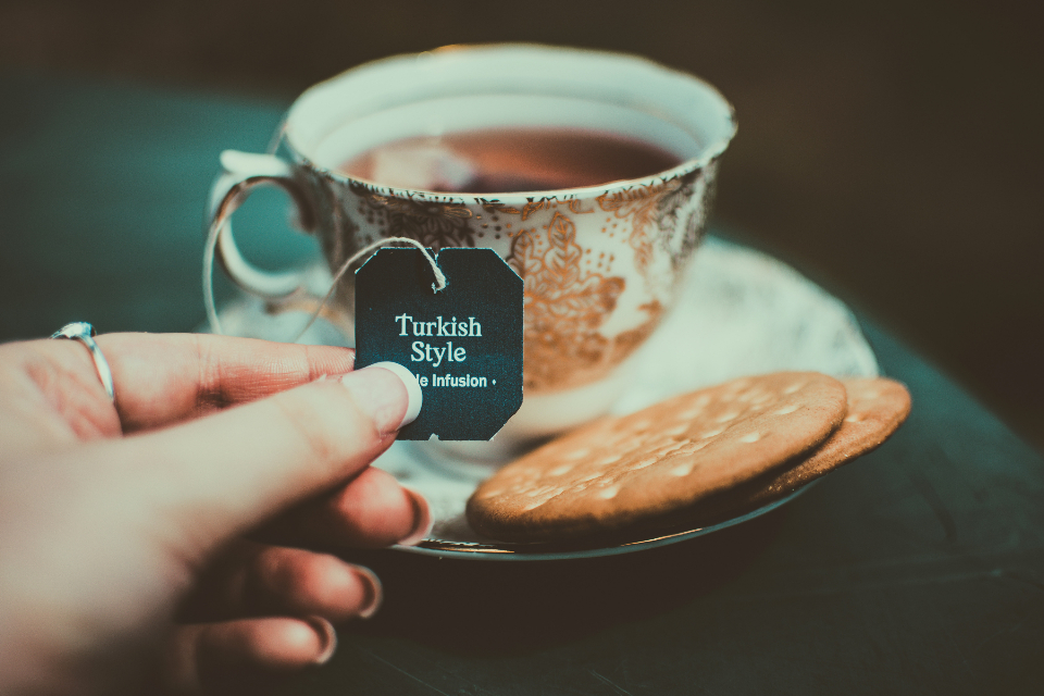 cup turkish tea hand biscuits cookies tea bag saucer drink food break chill