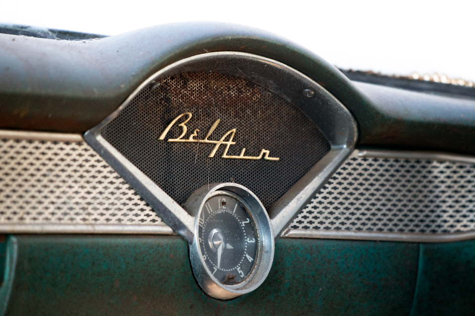 vintage car interior dashboard gauges emblem bel air chevy classic antique old aged weathered worn automotive automobile mechanic garage retro hot rod muscle car