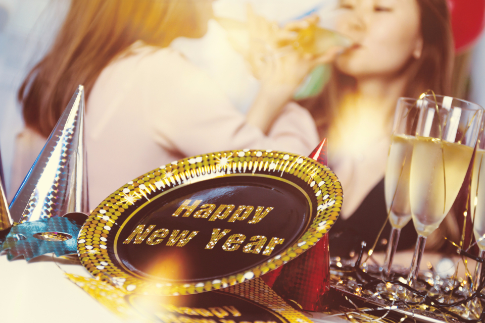 new year celebration woman champagne decoration drink glasses plate gold holiday people new year party