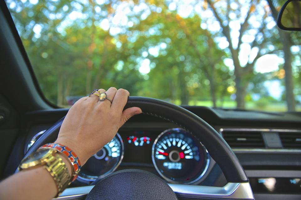 people woman accessories ring bracelet watch time clock car vehicle transportation steering wheel speedometer trees leaves green