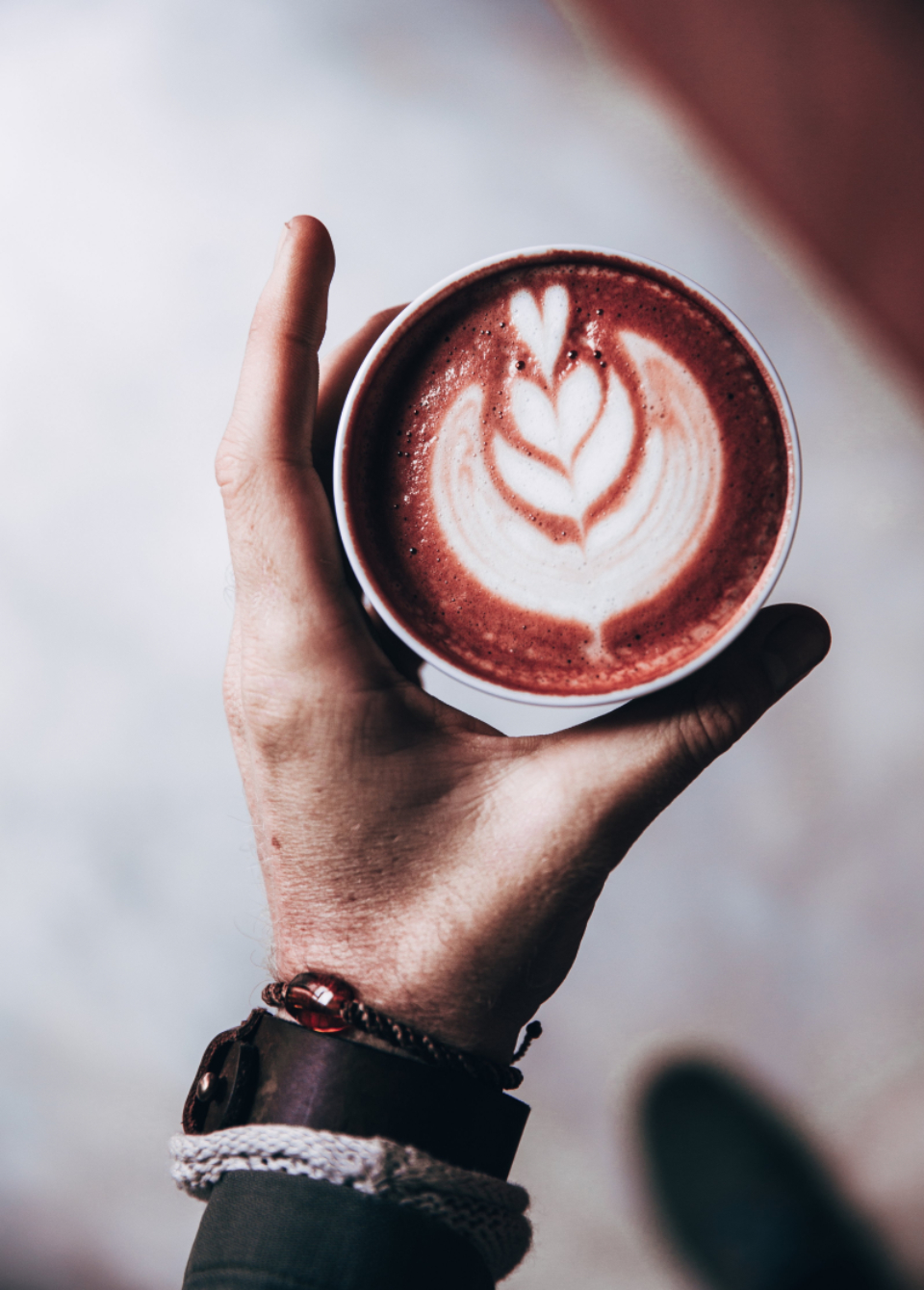 latte art hand close up drink beverage hot drink cappuccino coffee espresso cafe morning brewed milk design creative aroma caffeine restaurant holding person cream barista cup