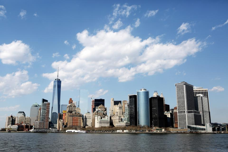 New York city buildings architecture skyline NYC towers high rises blue sky clouds
