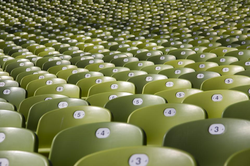 still chairs auditorium lines rows columns patterns perspective green