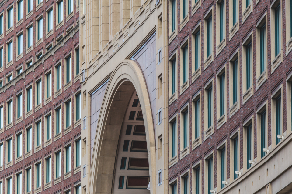 building exterior city urban windows old architecture ornate brick pattern design business office wall arch hotel
