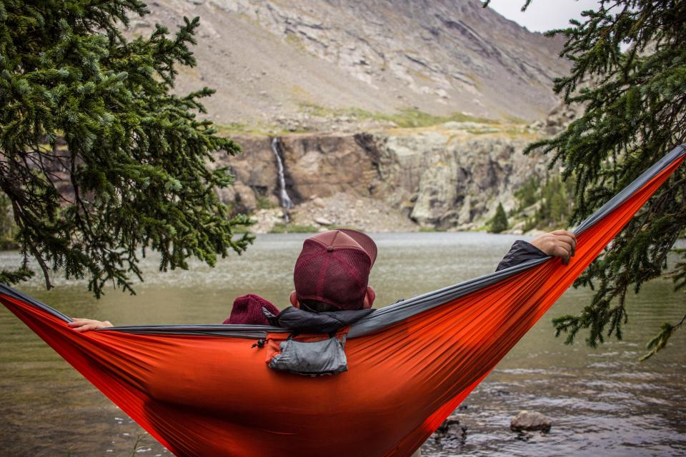 people man chill relax hammock relax nature trees green leaves water river