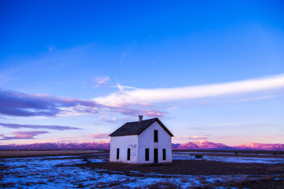 abandoned desolate house snow mountains evening dusk morning blue sky cold frozen