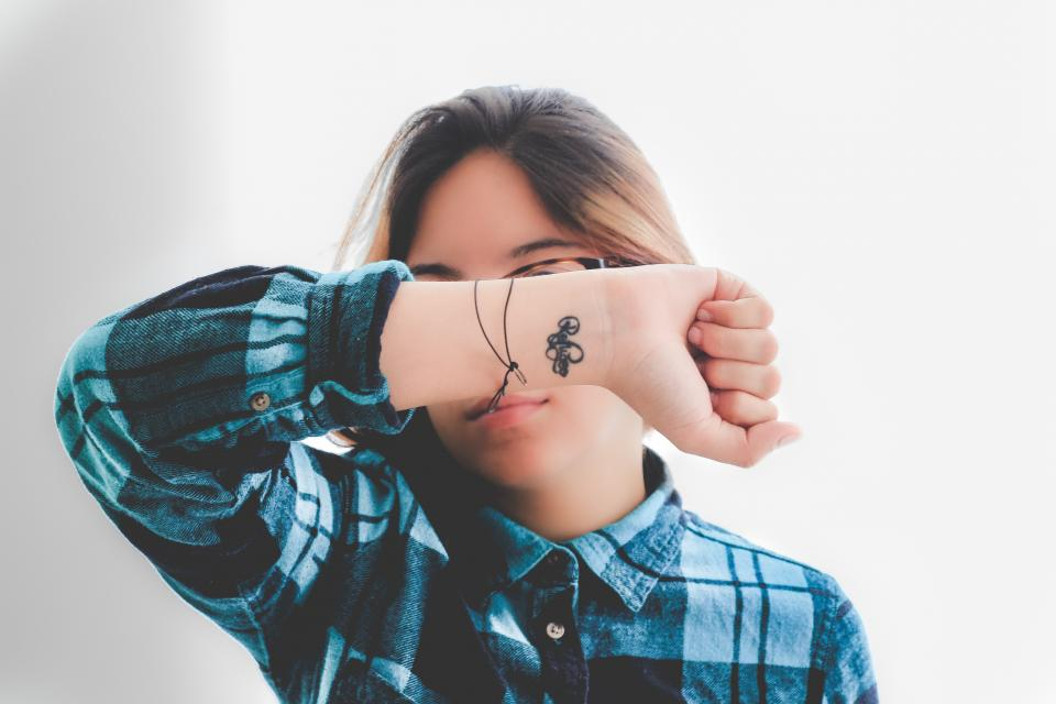 people woman tattoo hand flannel eyeglasses hand checkered blue