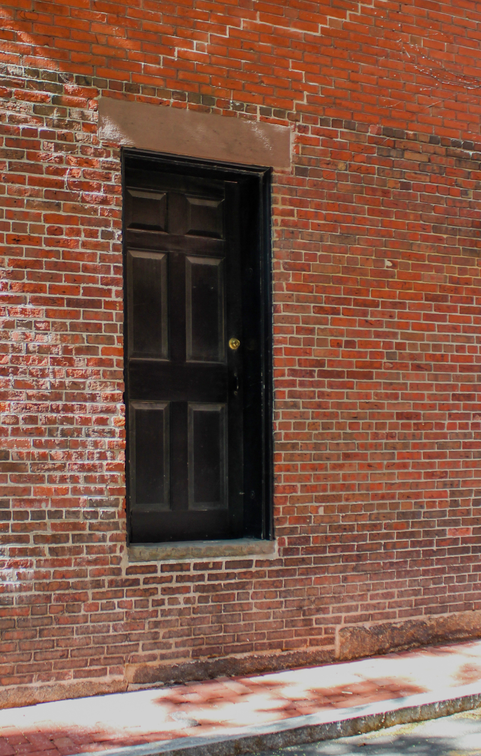 brick wall door sidewalk street urban exterior entrance building structure rustic bricks stone city