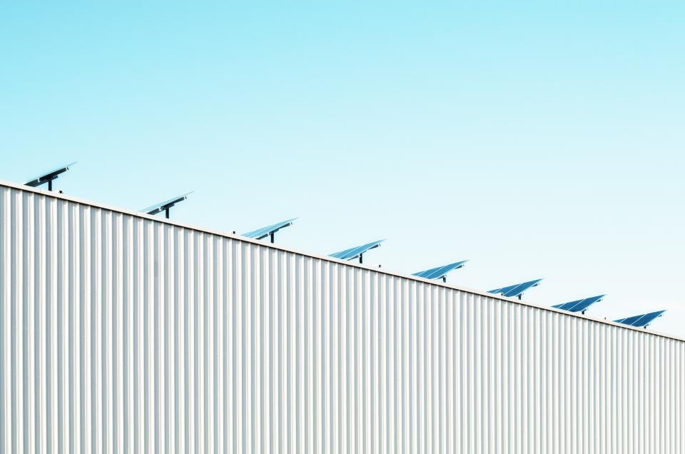 blue sky sunshine solar panels industrial building architecture