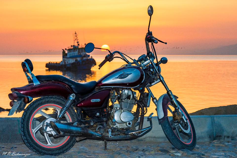 motorbike sunset view sea water ocean vintage bike transport fishing boat boat motorcycle hog