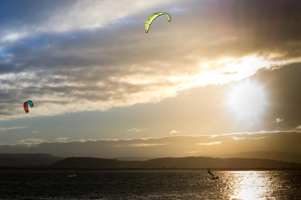 kite boarding kite surfing lake water sunset sky clouds sports