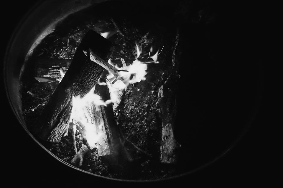 fire pit flames wood black and white dark night