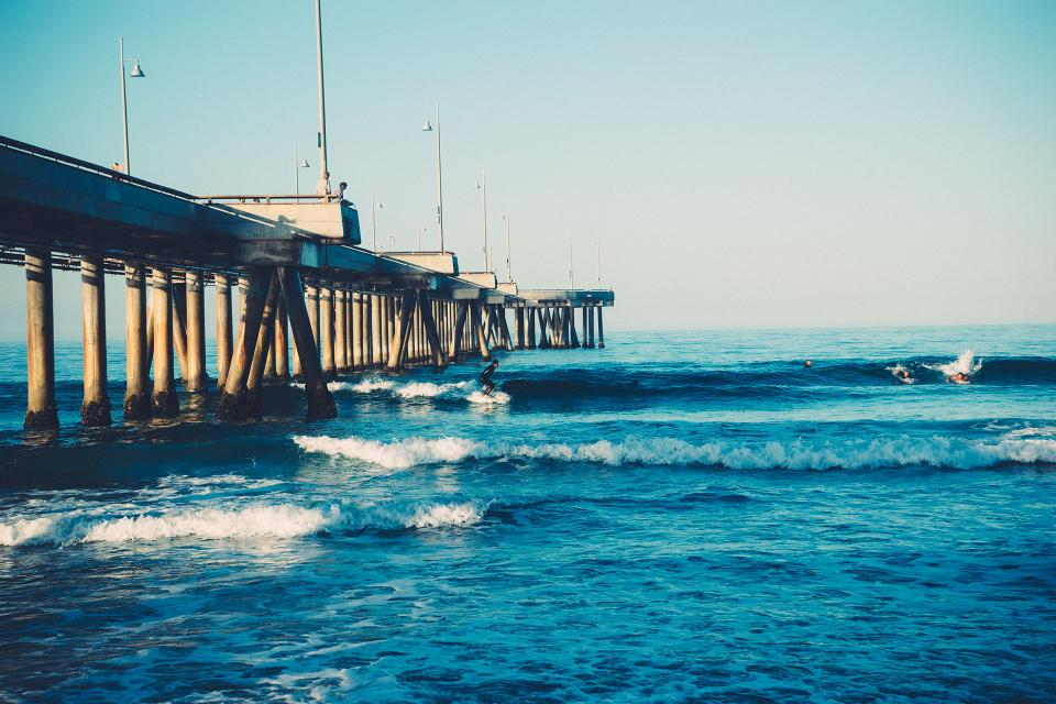 beach surfing surfer waves water ocean sea pier sunshine