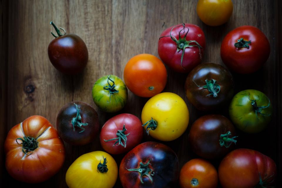 food vegetables rounds tomatoes wooden table colorful healthy